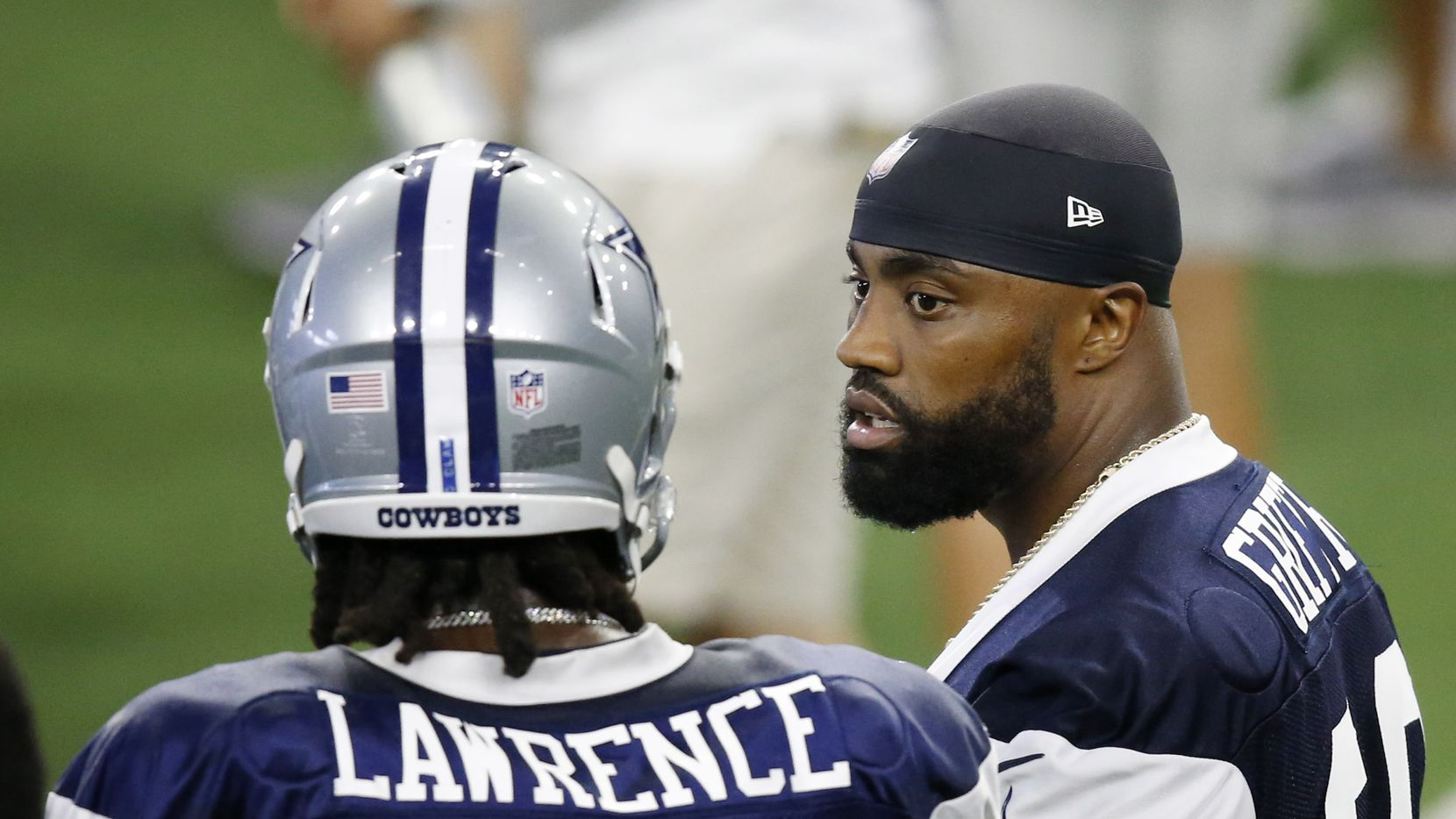 Dallas Cowboys defensive end Everson Griffen (96) talks with Dallas Cowboys defensive end DeMarcus Lawrence (90) during training camp at the Dallas Cowboys headquarters at The Star in Frisco, Texas on Monday, August 17, 2020.