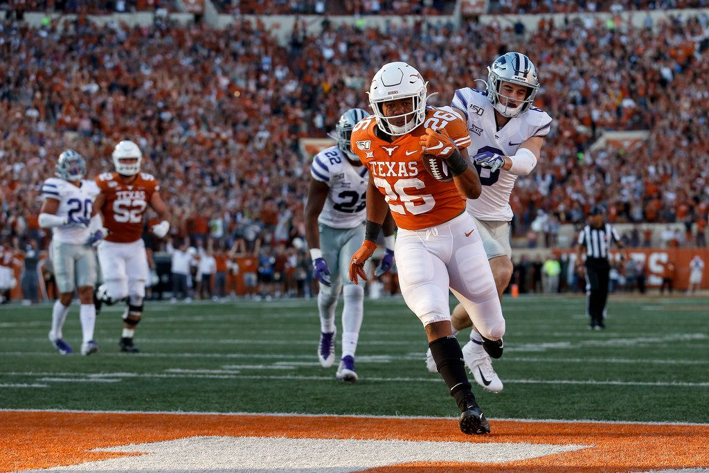 Keaontay Ingram #26 of the Texas Longhorns rushes for a touchdown defended by Johnathan Durham #6 of the Kansas State Wildcats in the fourth quarter at Darrell K Royal-Texas Memorial Stadium on November 9, 2019 in Austin, Texas.