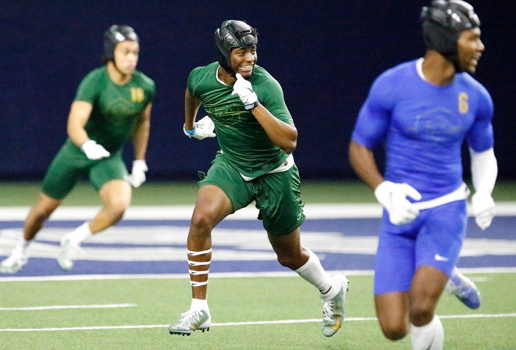 Jahari Rogers (center) of Arlington High School, plays defense during The Opening Finals, a football camp featuring some of the top high school recruits in the country. The final day of the event was held at The Star in Frisco on  Wednesday, July 3, 2019.  (Stewart F. House/Special Contributor)