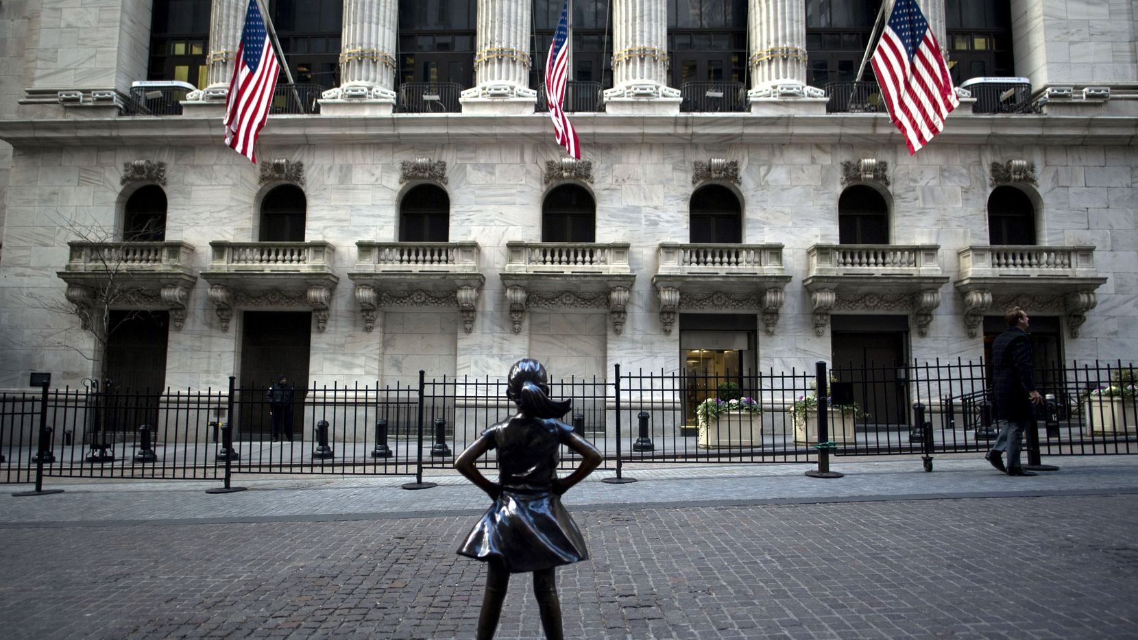 """The """"Fearless Girl"""" statue stands facing the New York Stock Exchange (NYSE) on Jan. 9, 2019 in New York. (Photo by Johannes Eisele/AFP)"""