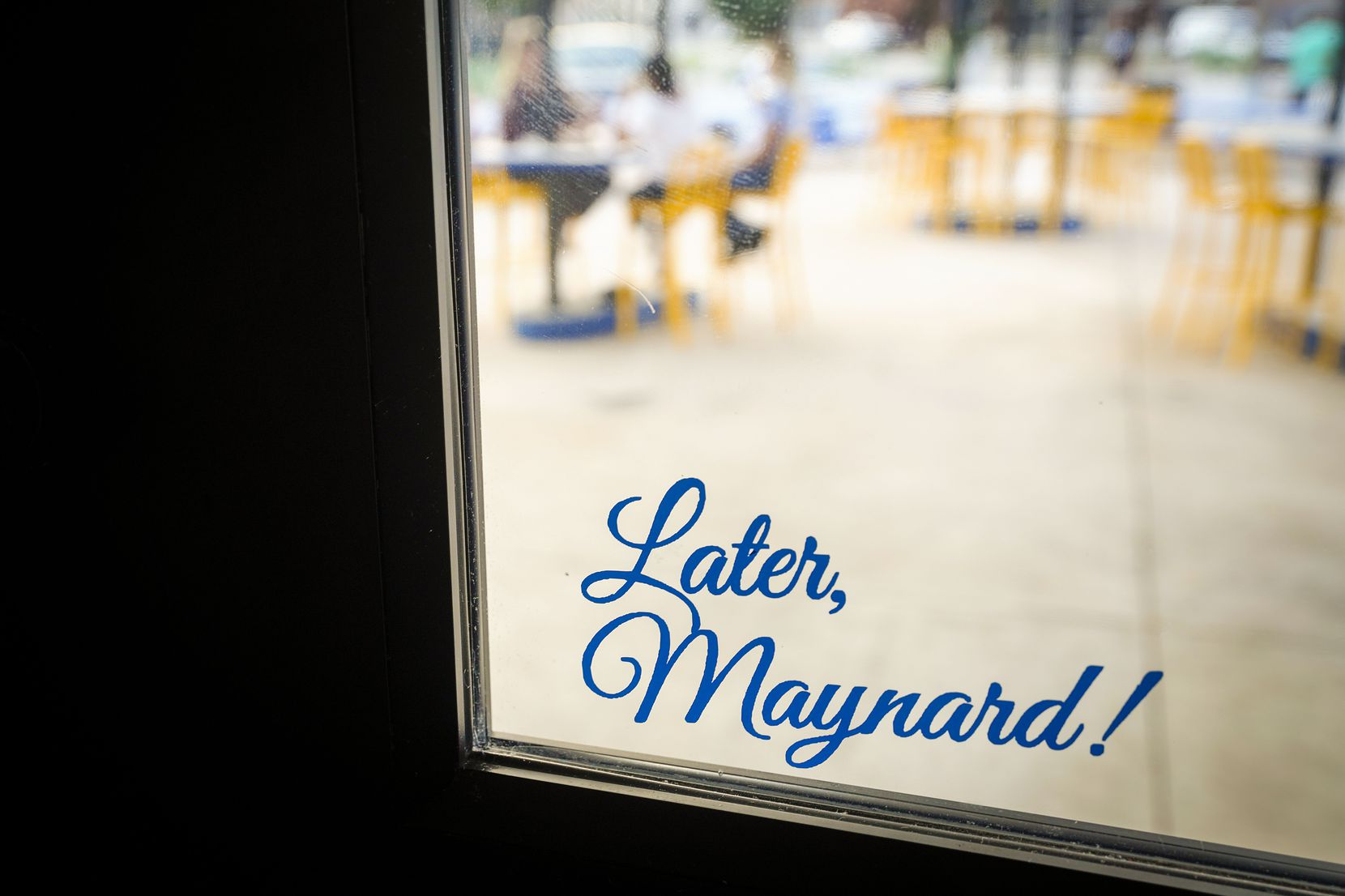 A sign on the front door at Thunderbird Station pays homage to Maynard Riegel's old Deep Ellum service station.