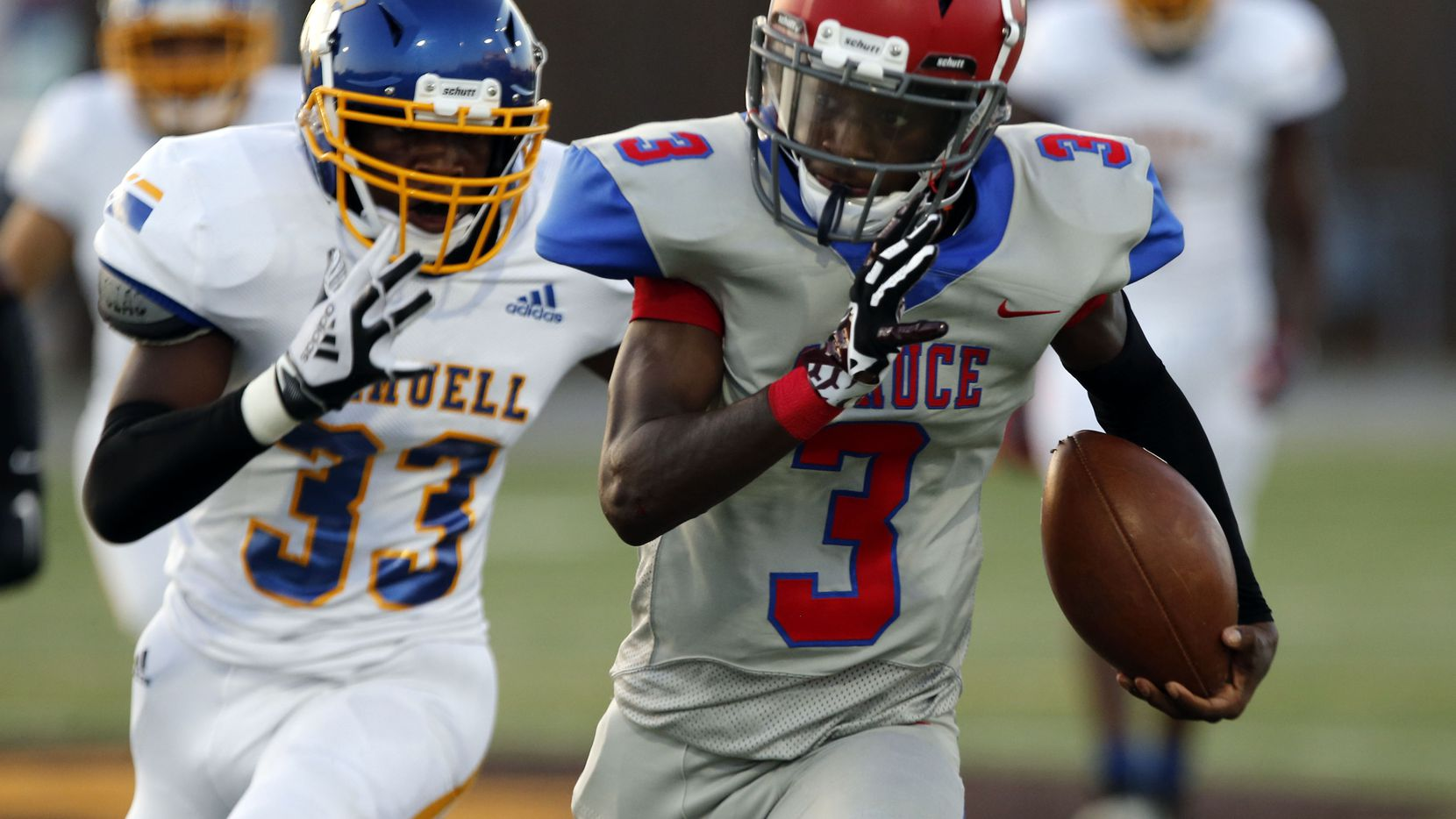 Samuell High defender Sharray Savage (33) chases Spruce QB Timad Cotton (3) during the first half of the season opening high school football game between against Samuell and Spruce High at Pleasant Grove Stadium in Dallas on Friday, August 27, 2021. (John F. Rhodes / Special Contributor)