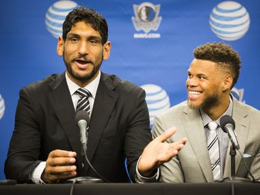 Dallas Mavericks draft pick Justin Anderson (right) listens as fellow pick Satnam Singh answers a question as the team introduces their 2015 draft picks during a press conference at American Airlines Center on Wednesday, July 8, 2015, in Dallas.