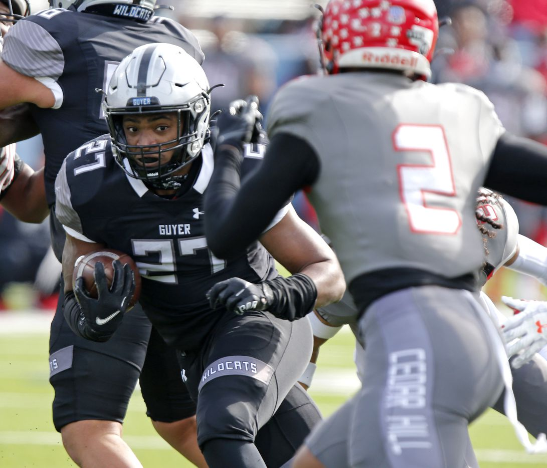 Denton Guyer High School running back Byron Phillips jr. (27) keeps his eyes on Cedar Hill High School free safety Kendall Stevens (2) during the first half as Denton Guyer High School played Cedar Hill High School in the Class 6A Division II, state semifinal at McKinney ISD Stadium in McKinney on Saturday, January 9, 2021.  (Stewart F. House/Special Contributor)
