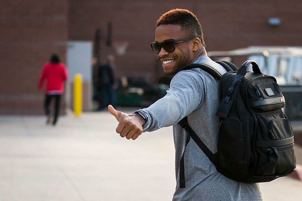 Texas Rangers outfielder Delino DeShields gives a thumbs up as he heads to the clubhouse on the day pitchers and catchers reported for spring training at the team's training facility on Wednesday, Feb. 14, 2018, in Surprise, Ariz. (Smiley N. Pool/The Dallas Morning News)