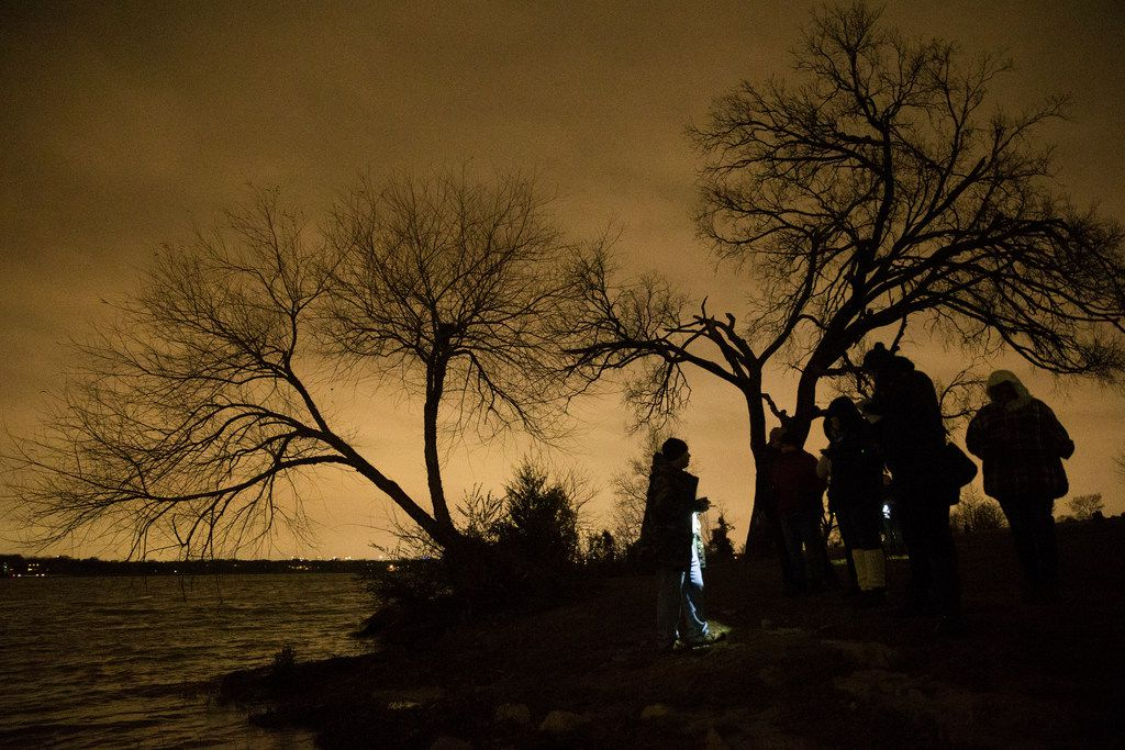 A group of people explore White Rock Lake with Haunted Rooms to discover if the lake is haunted in Dallas on Friday, December 14, 2018. They used various equipment used to detect if ghosts are in the area.. (Daniel Carde/The Dallas Morning News)