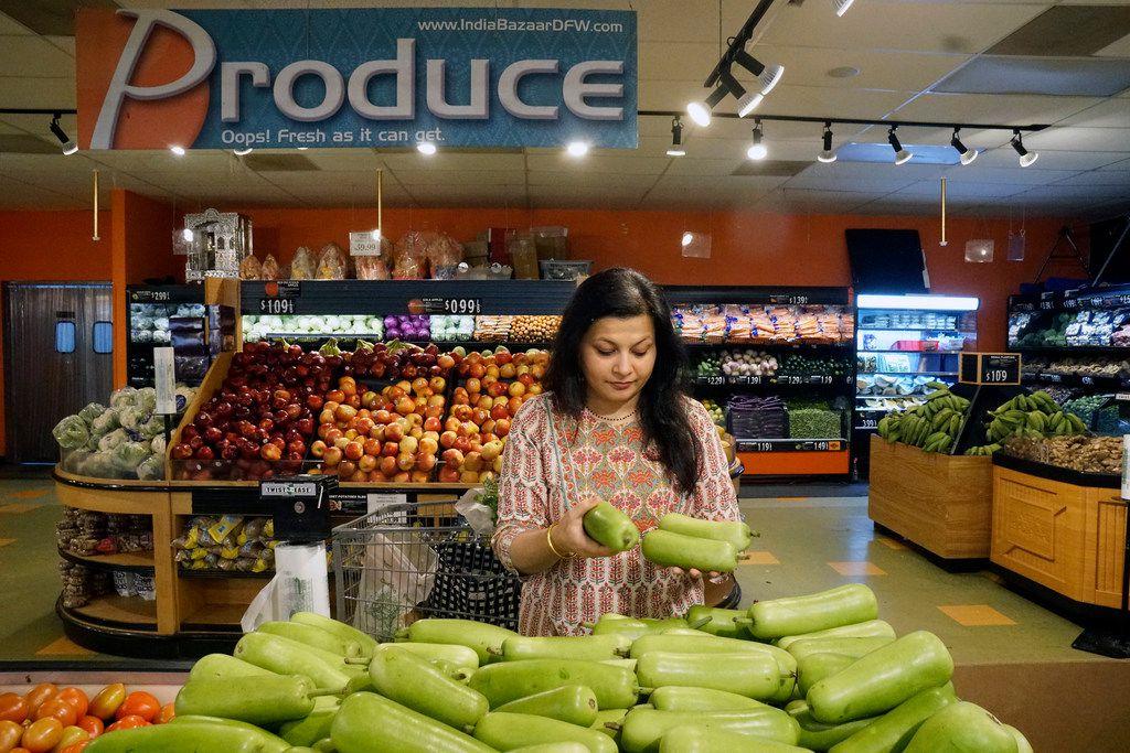 Sapna Punjabi-Gupta picks up some bottle gourd at the India Bazaar in Irving.