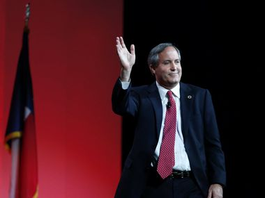 Texas Attorney General Ken Paxton waves to the crowd after speaking during the 2016 Texas Republican Convention at the Kay Bailey Hutchison Convention Center in Dallas, on Saturday, May 14, 2016.