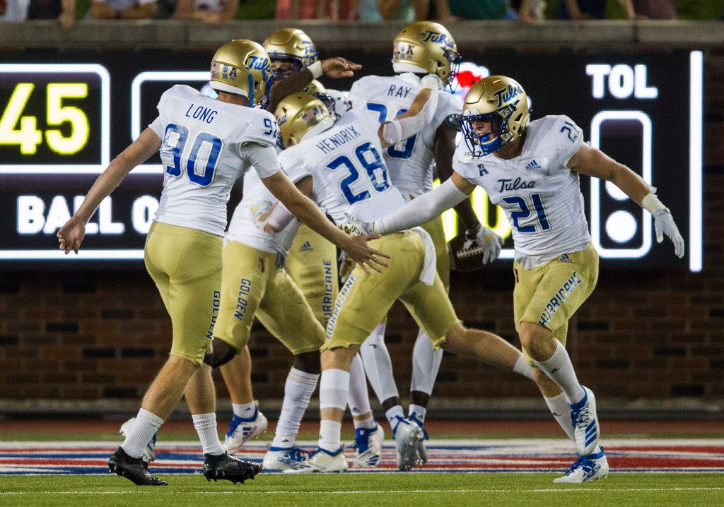 Tulsa Golden Hurricane players celebrate a touchdown during the second quarter of an NCAA football game between Tulsa and SMU on Saturday, October 5, 2019 at Ford Stadium on the SMU campus in Dallas. (Ashley Landis/The Dallas Morning News)