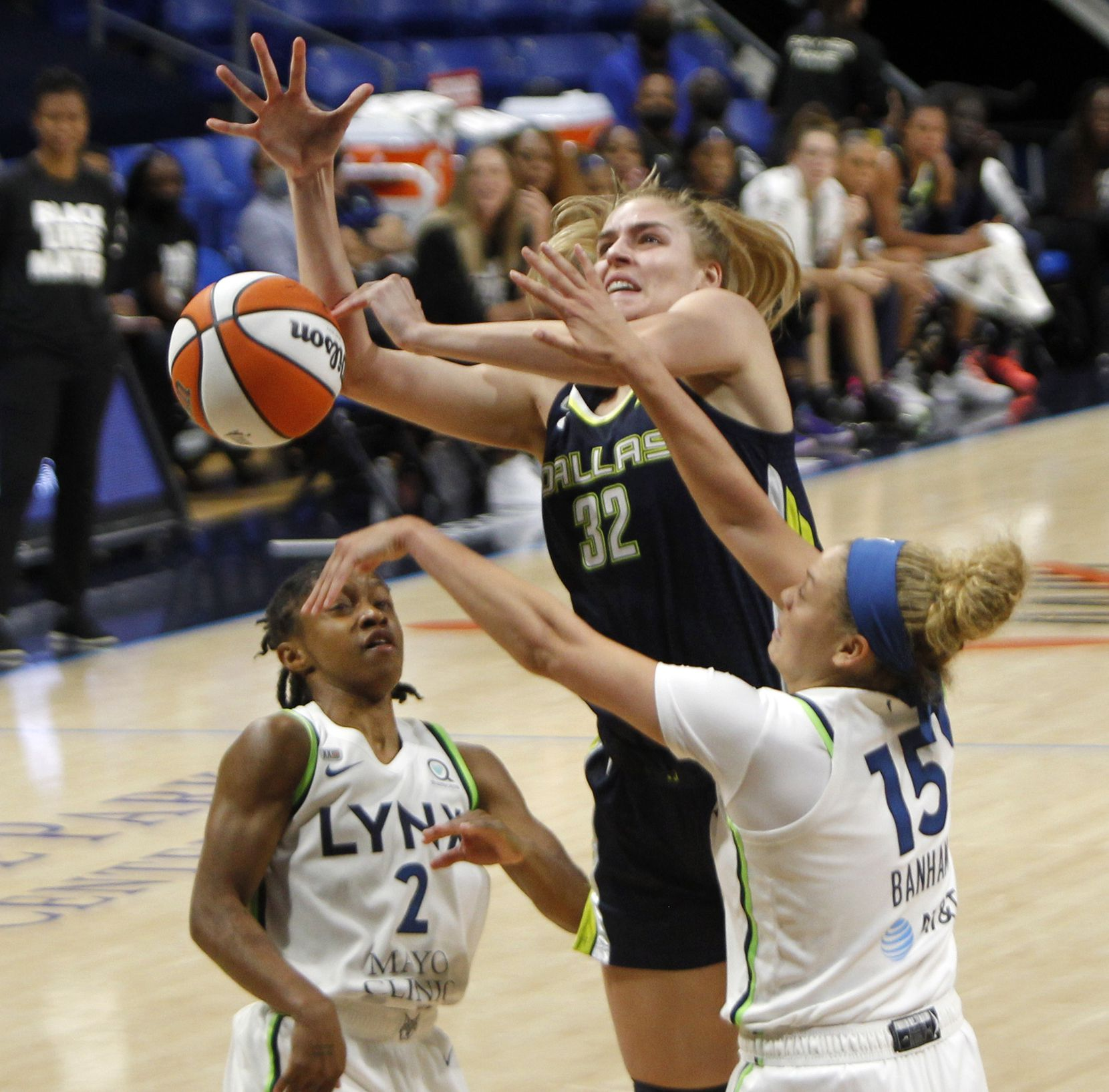 Dallas Wings center Bella Alarie (32) is fouled as she shoots against the defense of Minnesota Lynx guards Rachel Banham (15) and Crystal Dangerfield (2) during 3rd quarter action. The two teams played their WNBA game at College Park Center on the campus of the University of Arlington on June 17, 2021(Steve Hamm/ Special Contributor)