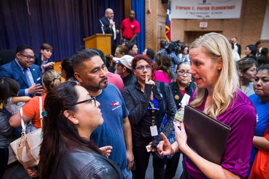 Jennifer Altieri, right, director of public affairs for Atmos Energy, speaks to concerned citizens at a town hall meeting to address the concerns of people who are effected by Atmos Energy gas leaks on Tuesday, February 27, 2018 at Foster Elementary in Dallas. The meeting follows a gas explosion that killed 12-year-old Linda Rogers. (Ashley Landis/The Dallas Morning News)