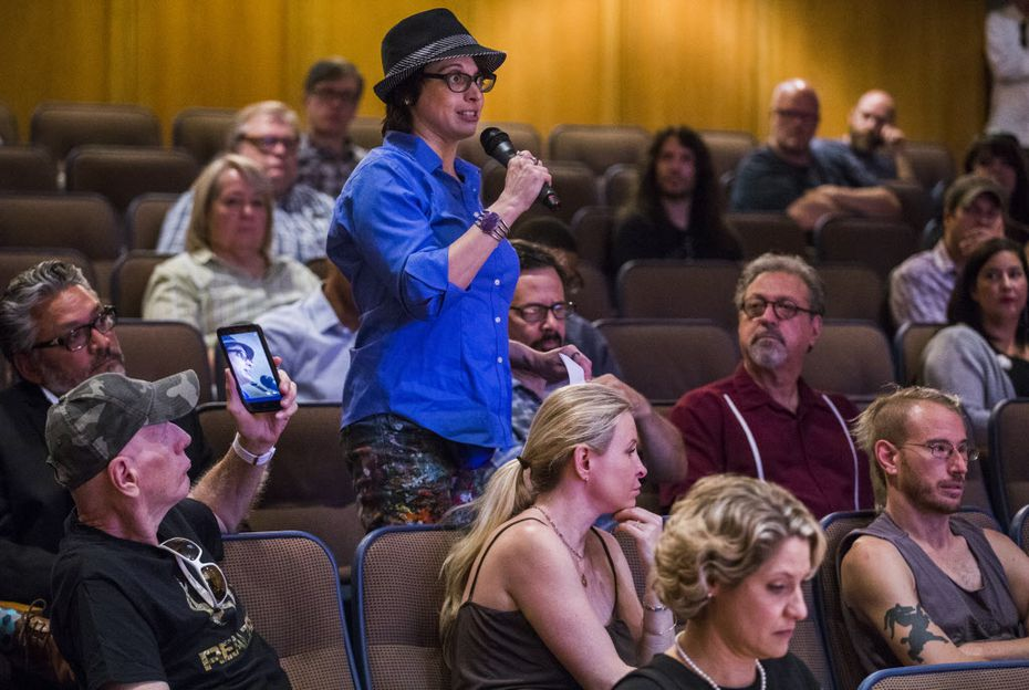 Lara Lenhoff asked a question as members of the Dallas art community met with fire marshals and city officials to discuss coding issues on Tuesday at the J. Erik Jonsson Central Library in downtown Dallas.