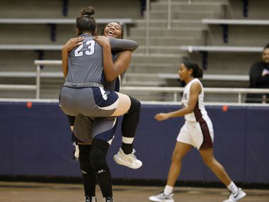 Wylie East's Kiley Hicks (23) and Akasha Davis (41) celebrate their overtime win (65-60) over Red Oak during the Class 5A Region II girls basketball semifinal on Feb. 26, 2021 in Flower Mound, Tx. (Michael Ainsworth/Special Contributor)