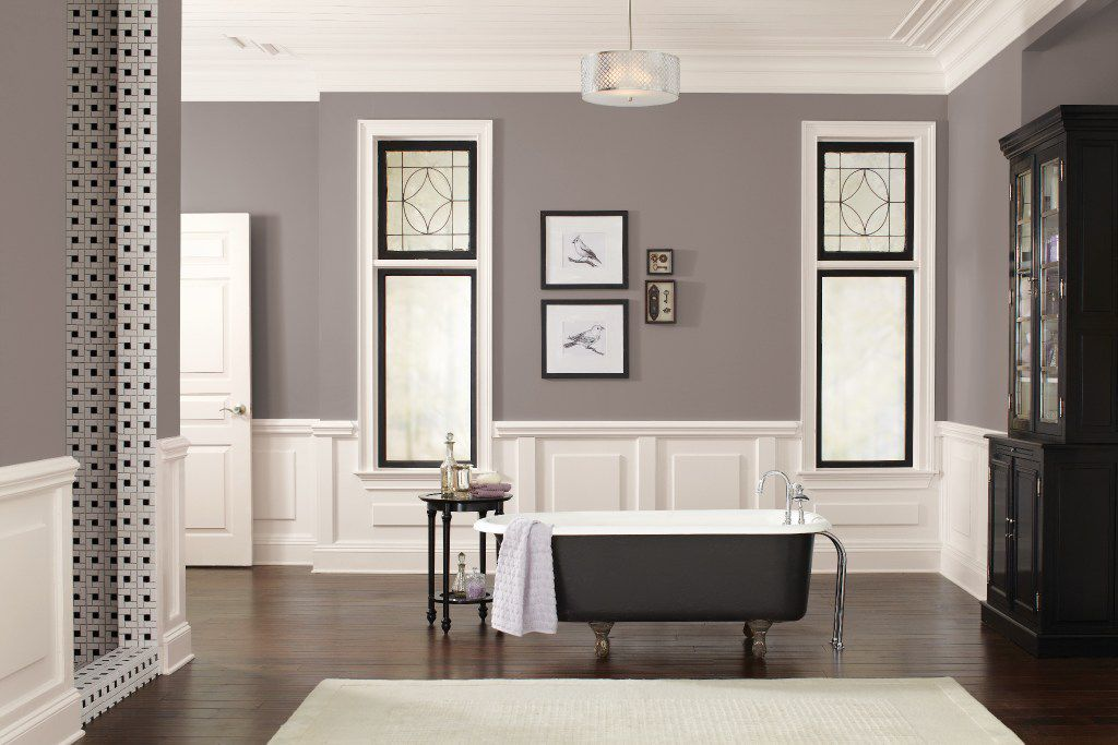 A deep, balanced neutral that combines warm and cool tones, Poised Taupe by Sherwin-Williams represents a transition away from monochrome gray tones. The color pairs well with both black and white.