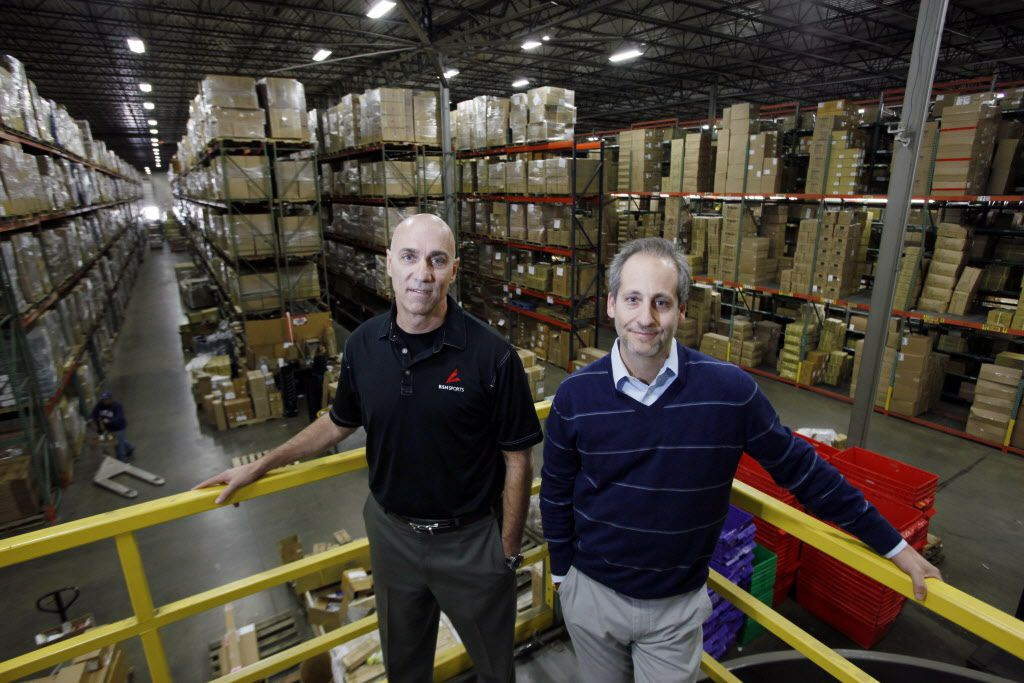 Terry Babilla, left, president, chief operating officer and general consul; and Adam Blumenfeld, chairman, chief executive officer of BSN Sports, on Wednesday, Feb. 25, 2015 at their onsite factory inside the main headquarters in Dallas. BSN Sports is the largest distributor of team sports apparel and equipment in the U.S. with 2015 sales expected to reach $500 million.