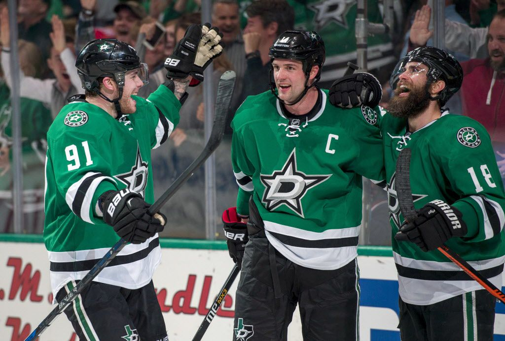 Mar 11, 2016; Dallas, TX, USA; Dallas Stars center Tyler Seguin (91) and left wing Jamie Benn (14) and right wing Patrick Eaves (18) celebrates a goal against Chicago Blackhawks goalie Corey Crawford (not pictured) during the second period at American Airlines Center. Mandatory Credit: Jerome Miron-USA TODAY Sports