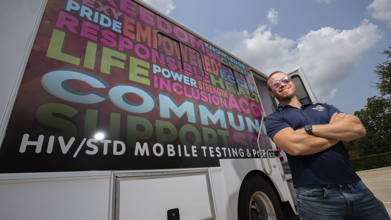JP Cano, prevention services director at Resource Center, stands outside the SexyHealth HIV testing mobile unit developed by the Dallas center.