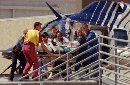 Emergency personnel rush one of nine Branch Davidians who survived the fire from a CareFlite helicopter into Parkland Hospital in Dallas. (Paula Nelson/Staff)