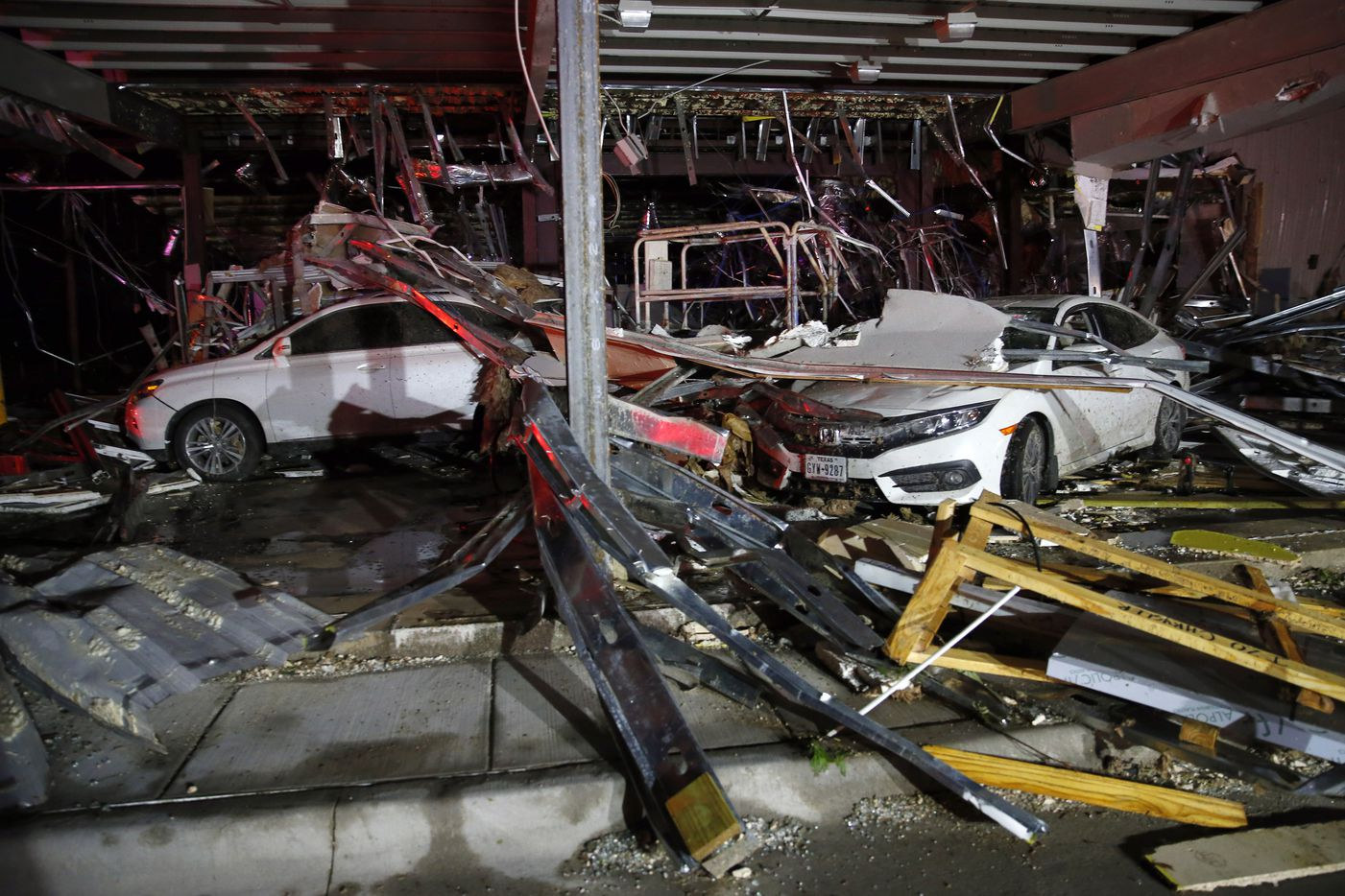 As the storm approached cars sought shelter inside a  car dealership that was under construction. According to the staff at the dealership the car occupants were unhurt. (Tom Fox/The Dallas Morning News)