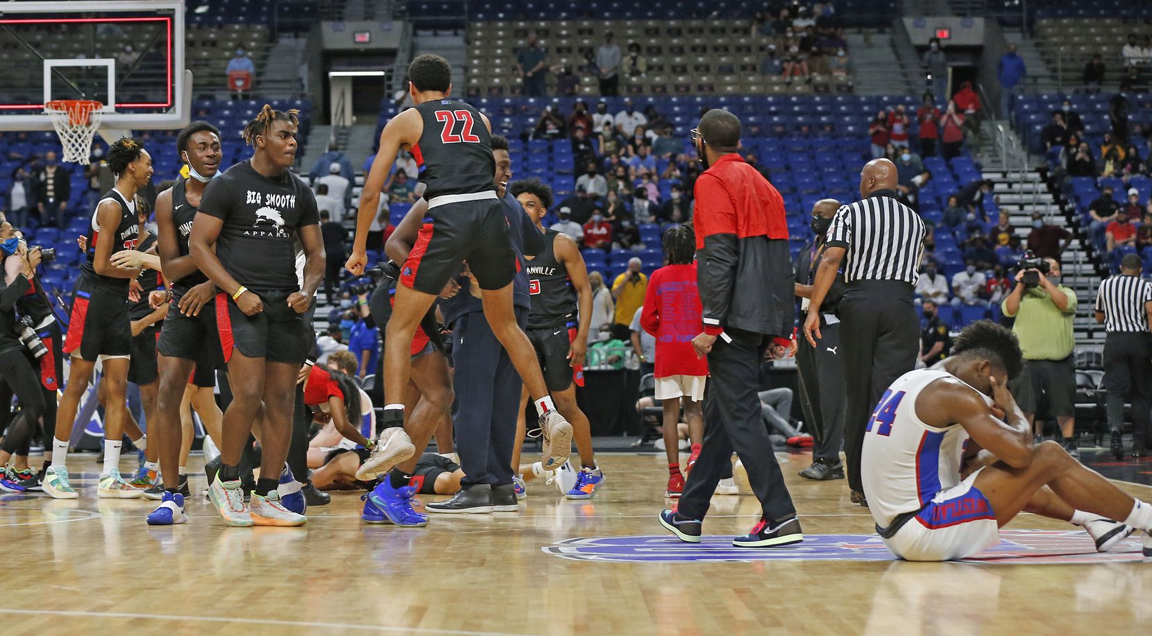 Westlake Kj Adams #24 sits on the floor as Duncanville celebrates their victory. UIL boys Class 6A basketball state championship game between Duncanville and Austin Westlake on Saturday, March 13, 2021 at the Alamodome.