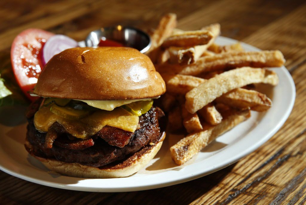 Sugarbacon's burger features a Wagyu beef patty dressed with aged cheddar, garlic mayo, bread-and-butter-pickles and a slice of sugarbacon. The Wagyu beef (and all the restaurant's beef) is sourced from Local Yocal, the renowned rancher-owned meat purveyor just around the corner.