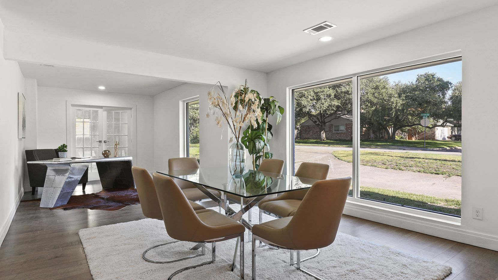 The three-bedroom contemporary-style design at 7326 La Cosa Drive in North Dallas has been reimagined with open spaces.