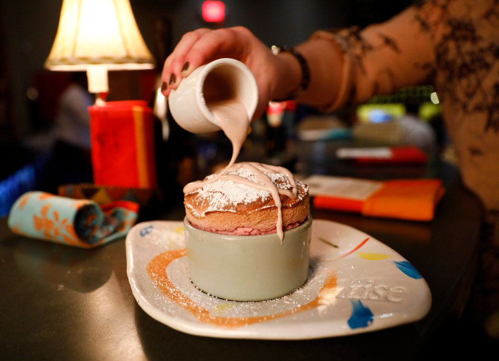 Staff drizzles a Raspberry Souffle dessert with a raspberry creme anglaise at Rise No. 3 in The Shops at Clearfork development in Fort Worth. The restaurant is known for its sweet and savory souffles.