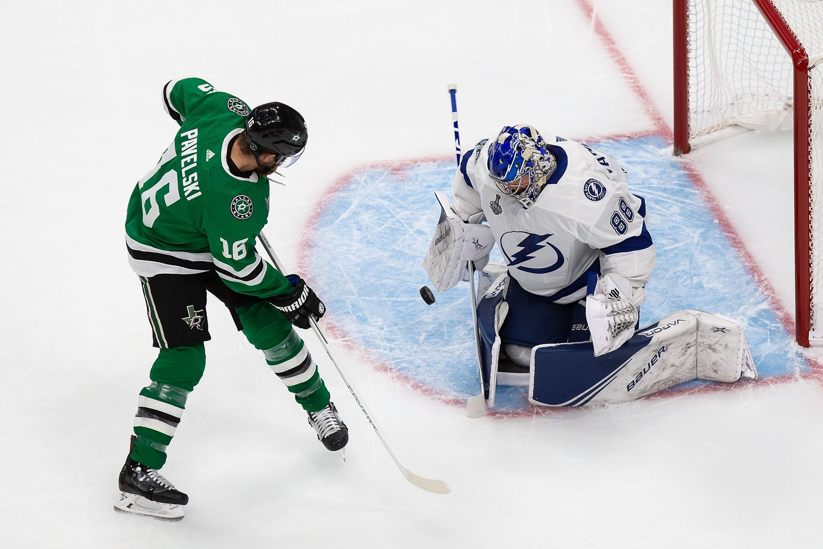 Joe Pavelski (16) of the Dallas Stars takes a shot on goaltender Andrei Vasilevskiy (88) of the Tampa Bay Lightning during Game Three of the Stanley Cup Final at Rogers Place in Edmonton, Alberta, Canada on Wednesday, September 23, 2020. (Codie McLachlan/Special Contributor)