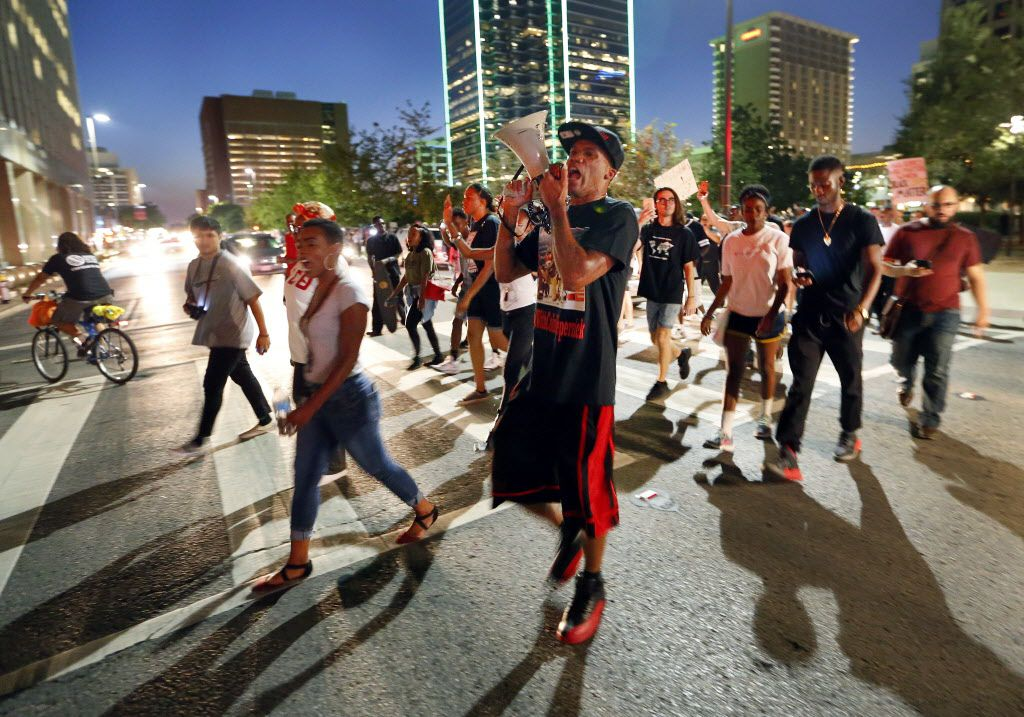 Protestors cross Commerce St. during the Next Generation Action Network protest in downtown Dallas, Thursday, September 22, 2016. In response to the police killings, the group is standing in solidarity with the families and all of those who want justice for all. (Tom Fox/The Dallas Morning News)