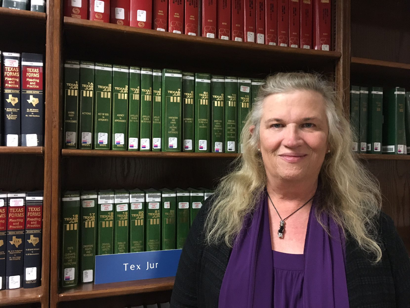 Claire Bow, a former Texas assistant attorney general who once led the State Office of Risk Management, poses during a November 2016 meeting of the Trans Name and Gender Marker Project, a free law clinic for transgender people sponsored by the Mithoff Pro Bono Program at the University of Texas at Austin, at the Travis County Law Library.