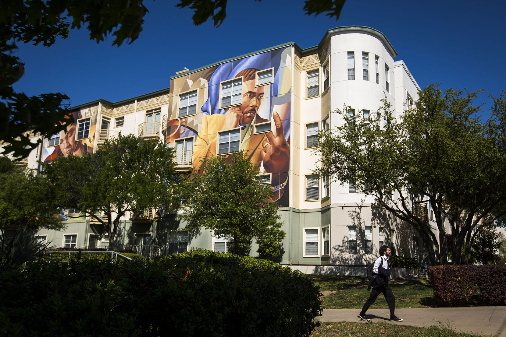 The four-story apartment buildings were previously covered in bright murals.