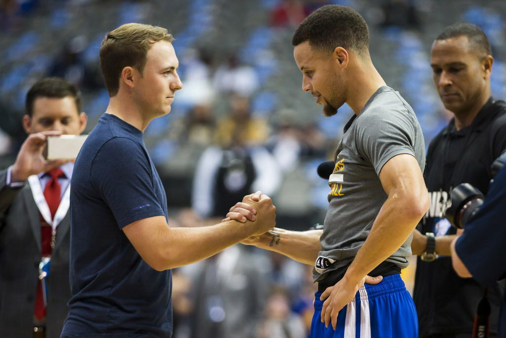 Golden State Warriors guard Stephen Curry greets golfer Jordan Spieth as he warms up before an NBA basketball game against the Dallas Mavericks at American Airlines Center on Friday, March 18, 2016, in Dallas. (Smiley N. Pool/The Dallas Morning News)
