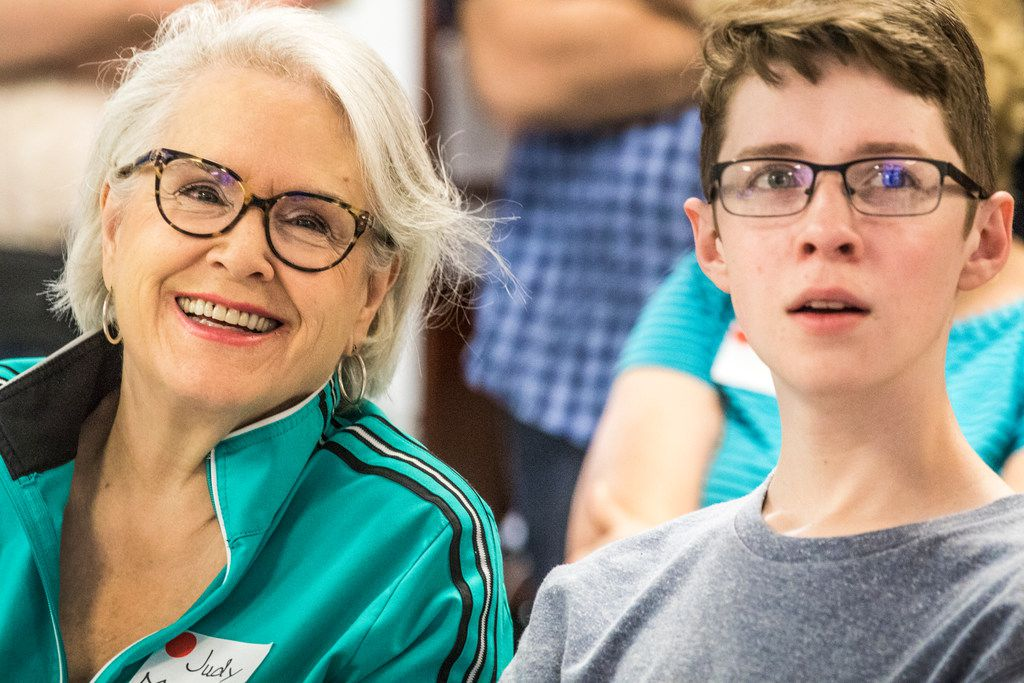 Judy Marcum and Garrett Mathiews, both of Dallas, listen to a presentation led by Peter Weyand during Science in the City at Southern Methodist University.