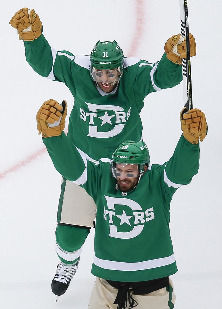 Dallas Stars left wing Blake Comeau (15) celebrates with center Andrew Cogliano (11) after scoring during the second period of a NHL Winter Classic matchup between the Dallas Stars and the Nashville Predators on Wednesday, January 1, 2020 at Cotton Bowl Stadium in Dallas. (Ryan Michalesko/The Dallas Morning News)