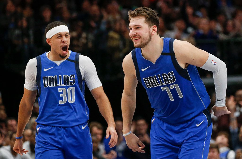 Dallas Mavericks forward Luka Doncic (77) celebrates scoring alongside guard Seth Curry (30) during the second half of a NBA basketball game between the Dallas Mavericks and the Charlotte Hornets on Saturday, Jan. 4, 2019 at American Airlines Center in Dallas.