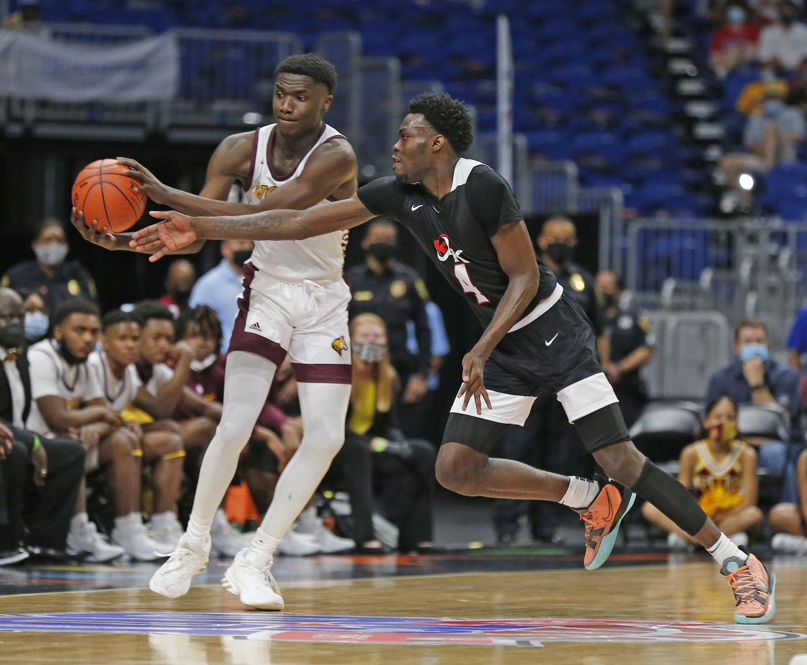 Dallas Kimball Kyron Henderson #4 tries for a steal. UIL boys Class 5A basketball state championship game on Friday, March 12, 2021 at the Alamodome.