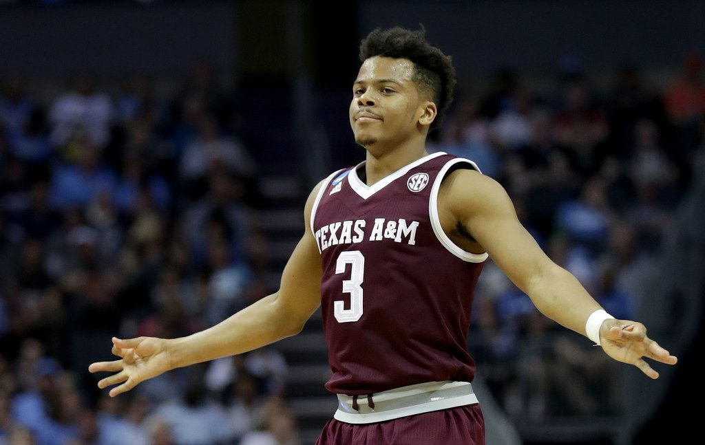 CHARLOTTE, NC - MARCH 18:  Admon Gilder #3 of the Texas A&M Aggies reacts after a three point shot against the North Carolina Tar Heels during the second round of the 2018 NCAA Men's Basketball Tournament at Spectrum Center on March 18, 2018 in Charlotte, North Carolina.  (Photo by Streeter Lecka/Getty Images)