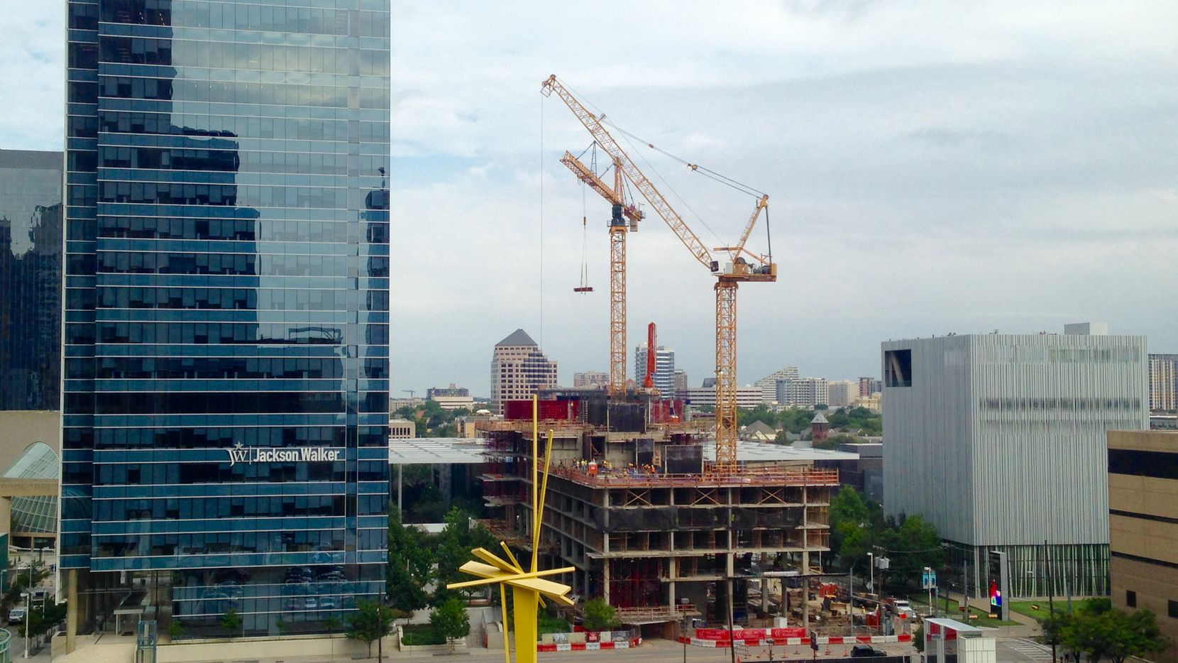 The Hall Arts Residences and Hotel is under construction on Ross Avenue between the KPMG Plaza office tower and the Wyly Theater.