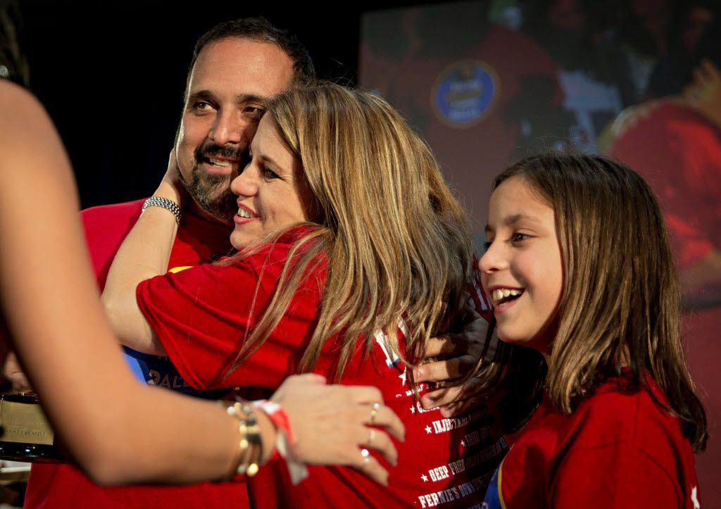 """(From left) Isaac Rousso, his wife Lily Rousso and their daughter, Sara Rousso, react after they won """"Most Creative"""" for their Fried Cookie Fries during the 2016 Big Tex Choice Awards Sunday, August 28, 2016 at Fair Park in Dallas. The annual event, held ahead of the State Fair of Texas, recognizes the best fried foods entered into consideration for sale at the fair. (G.J. McCarthy/The Dallas Morning News)"""