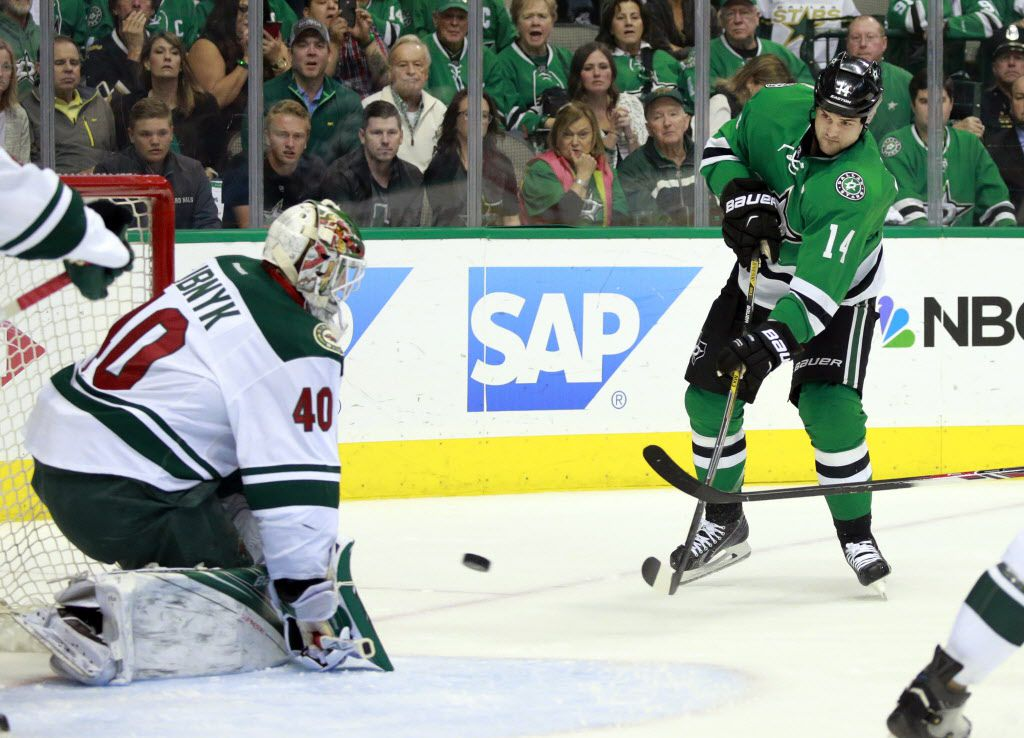 Dallas Stars left wing Jamie Benn (14) attempts a shot on Minnesota Wild goalie Devan Dubnyk (40) in the first period during Game 5 of the Western Conference Quarterfinals at the American Airlines Center in Dallas, Friday, April 22, 2016. (Tom Fox/The Dallas Morning News)