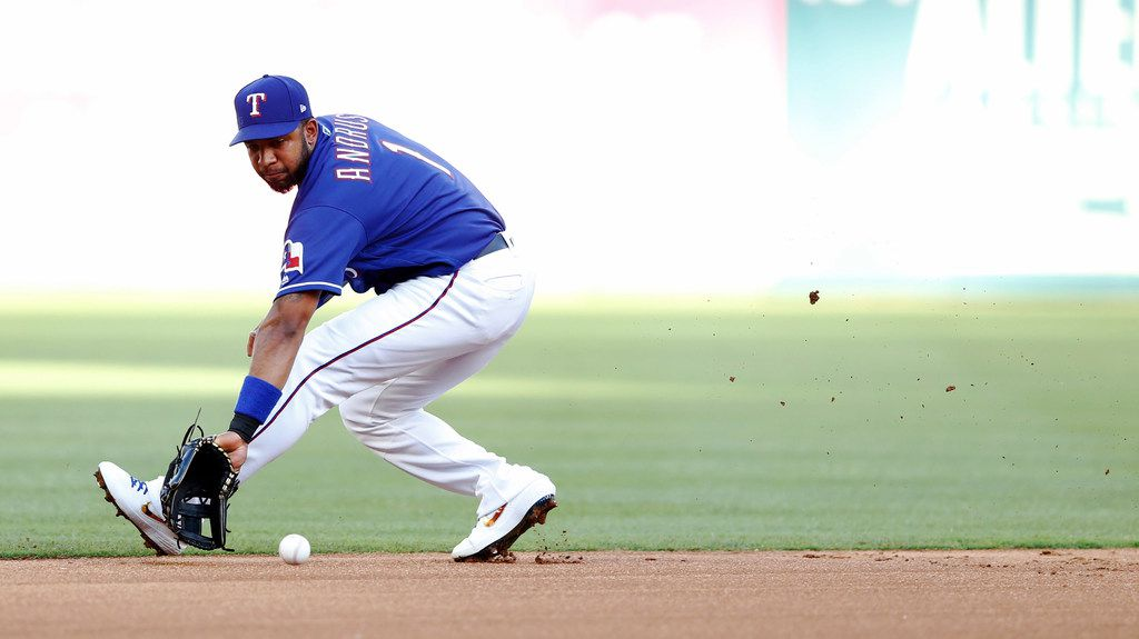 Texas Rangers shortstop Elvis Andrus (1) fields a ball hit by Los Angeles Angels first baseman Albert Pujols (5) during the first inning of play at Globe Life Park in Arlington, Texas on Tuesday, July 2, 2019.