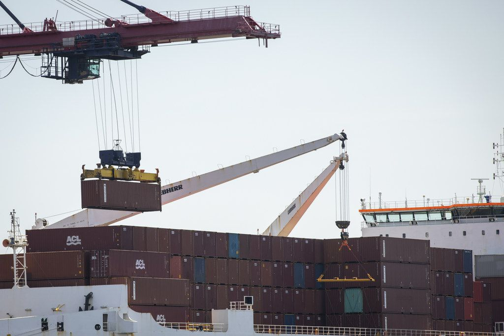 A shipping container is loaded onto a cargo ship at the New York Container Terminal (formerly known as Howland Hook Marine Terminal) in Staten Island as seen from Elizabeth, N.J., on May 7, 2019. U.S. Trade Representative Robert Lighthizer has confirmed that the Trump administration will raise tariffs on $200 billion worth of Chinese goods beginning Friday.