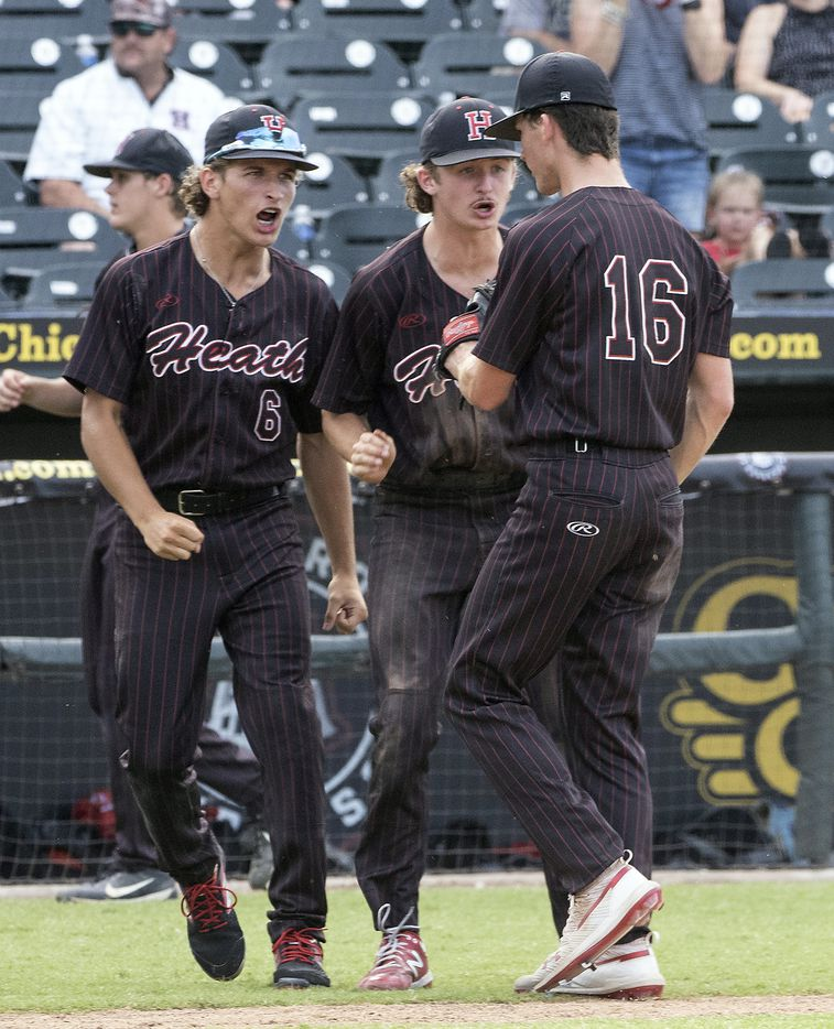 Rockwall-Heath Caden Fiveash, (16), is met by teammates Andrew Daniels, (6), and Baylor Baumann, (1), after getting out of a tough sixth inning against Keller during the 2021 UIL 6A state baseball final held, Saturday, June 12, 2021, in Round Rock, Texas.  Rockwall-Heath defeated Keller 4-3.   (Rodolfo Gonzalez/Special Contributor)