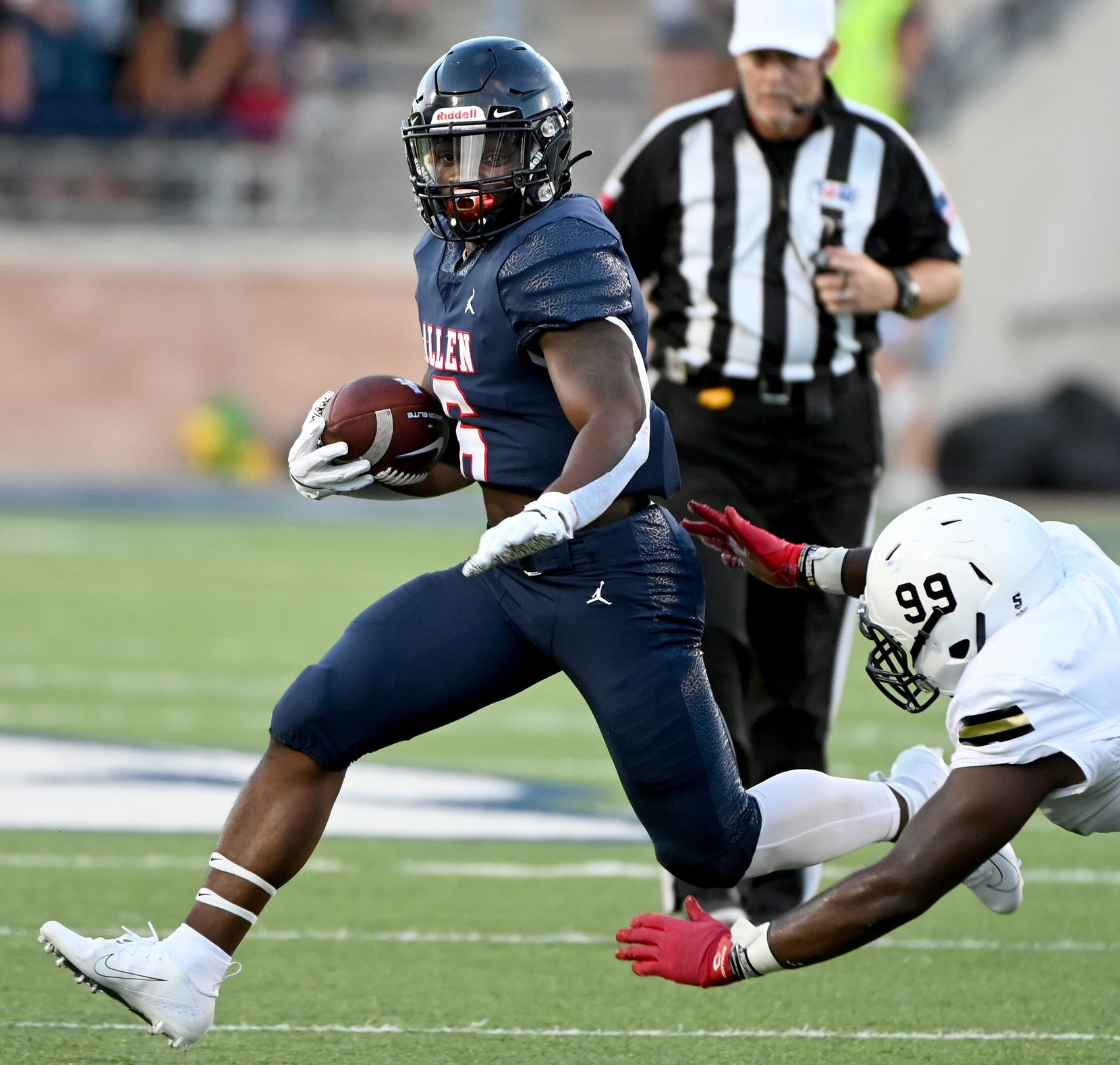 Allen's Devyn Turner runs through a tackle attempt by Plano East's Cedric Diggs (99) in the first half during a high school football game between Plano East and Allen, Friday, Aug. 27, 2021, in Allen, Texas. (Matt Strasen/Special Contributor)