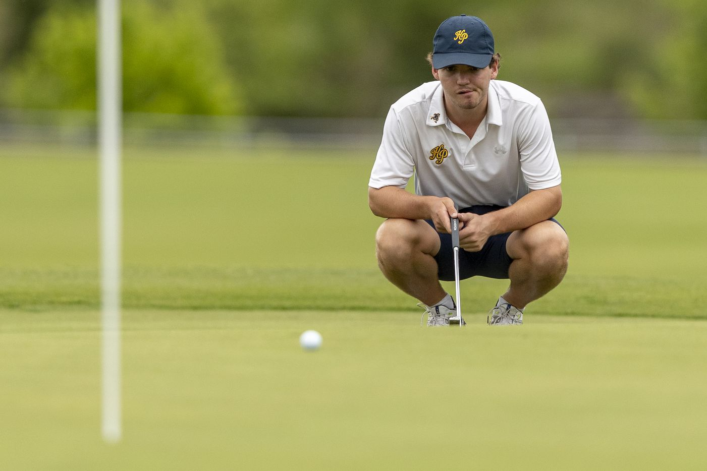 Highland ParkÕs Key Coker studies his shot on the 9th green during round 1 of the UIL Class 5A boys golf tournament in Georgetown, Monday, May 17, 2021. (Stephen Spillman/Special Contributor)