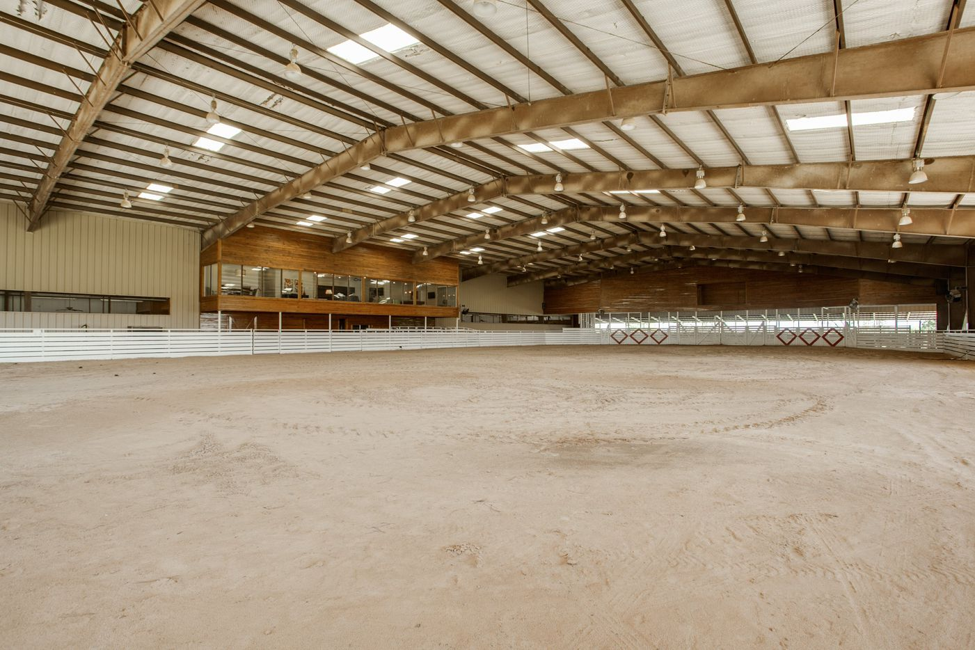 The property boasts a 32,000-square foot show barn and indoor arena, with a glass-enclosed luxury viewing suite.