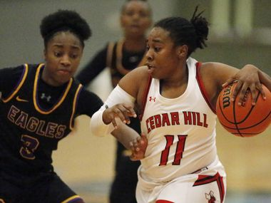 Cedar Hill's Portia Adams (11) is defended by Richardson's Zariah Tillman during Cedar Hill's 51-42 first-round playoff win Tuesday.
