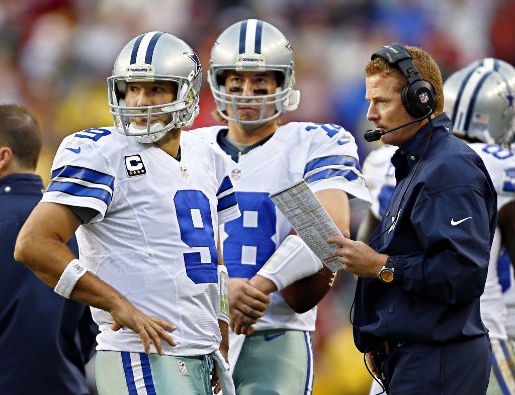 Dallas Cowboys quarterback Tony Romo (9) and quarterback Kyle Orton (18) look pack at the field of play as they talk with head coach Jason Garrett