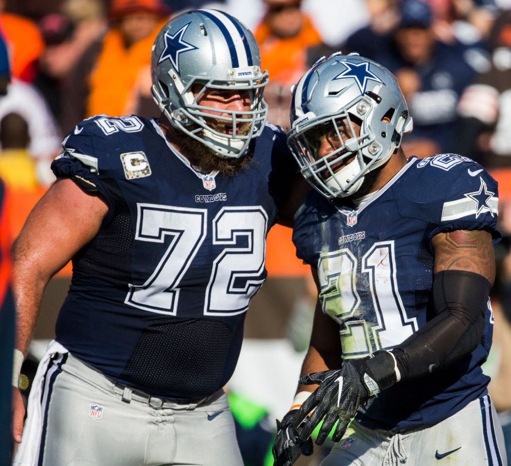 Dallas Cowboys center Travis Frederick (72) pats running back Ezekiel Elliott (21) on the helmet during the second quarter of their game against the Cleveland Browns on Sunday, November 6, 2016 at FirstEnergy Stadium in Cleveland, Ohio.  (Ashley Landis/The Dallas Morning News)