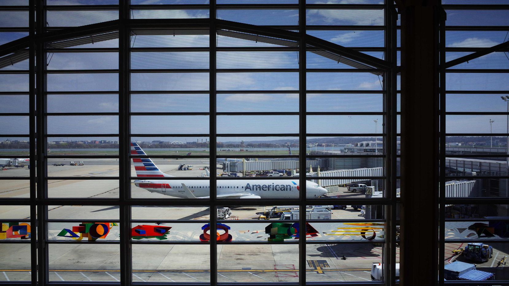(FILES) In this file photo taken on March 17, 2020 an American Airlines plane is seen from a terminal of Reagan National Airport in Arlington, Virginia.